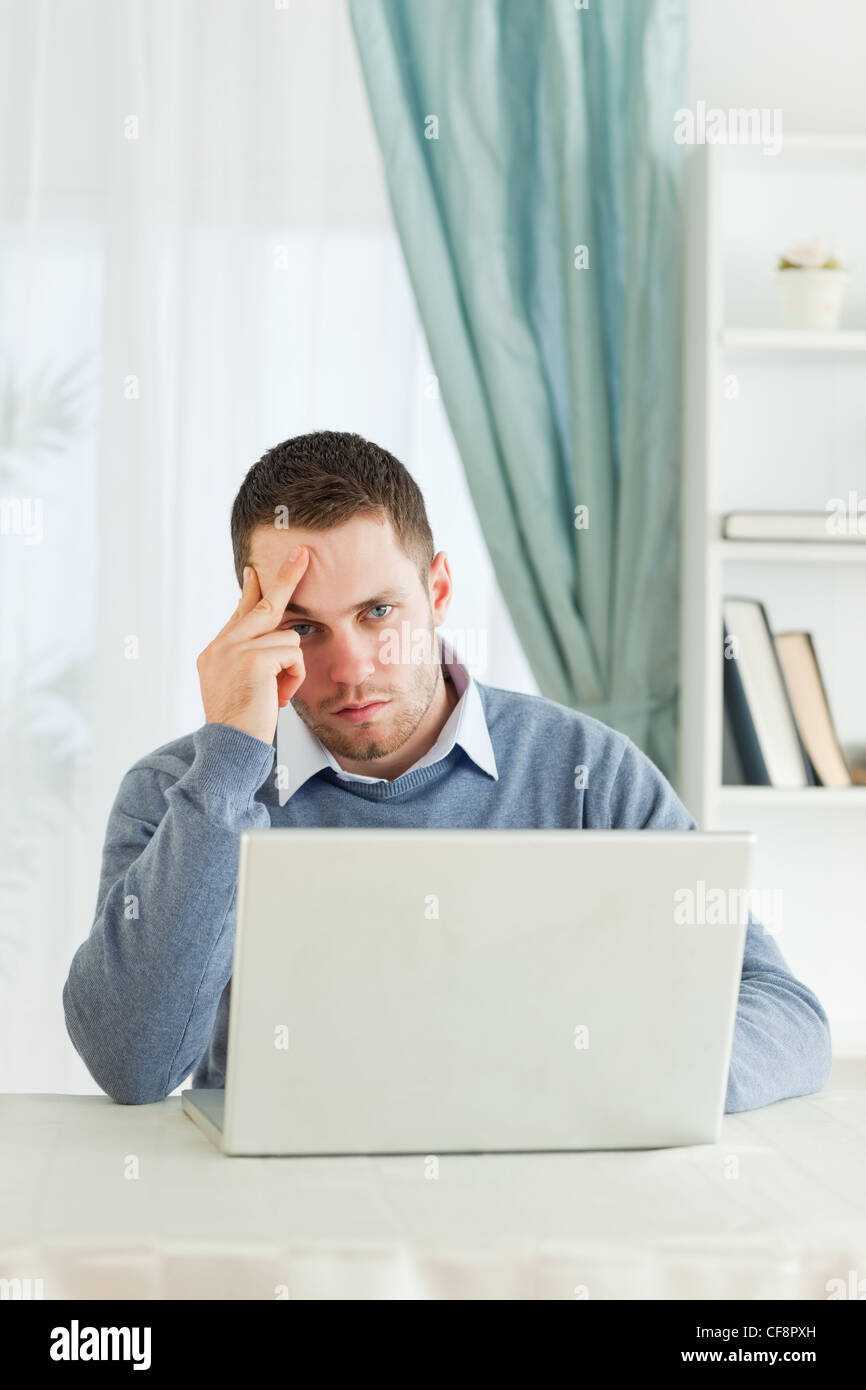 Worn out businessman in his homeoffice - Stock Image
