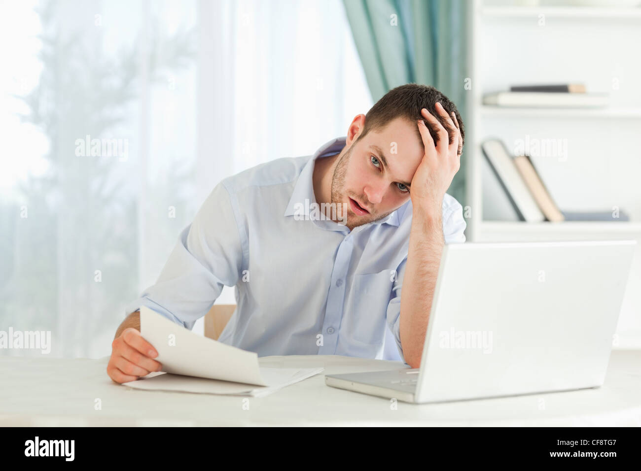 Businessman received an alarming letter Stock Photo