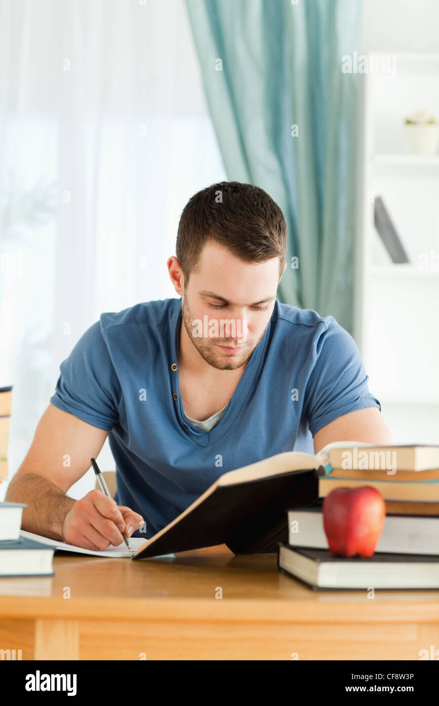 Student working through subject materials - Stock Image