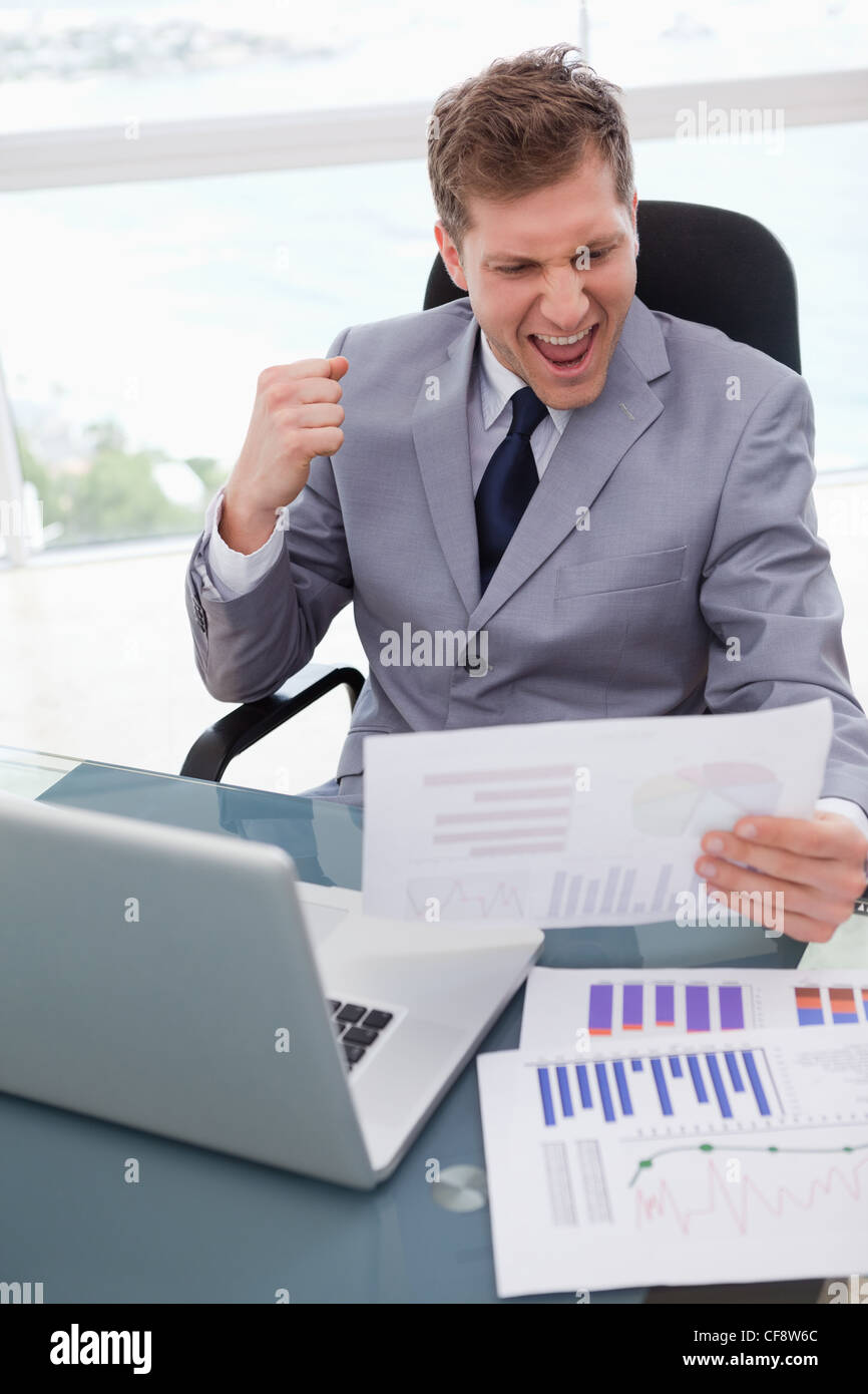 Businessman loves the result of market research - Stock Image