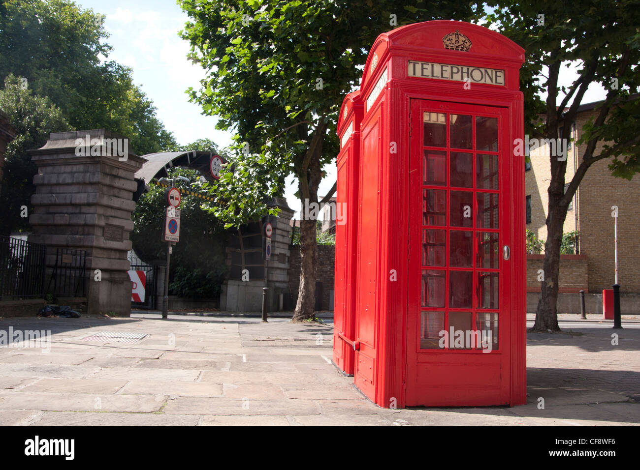The red telephone box is a public telephone kiosk designed by Sir Giles Gilbert Scott, and can still be seen throughout - Stock Image