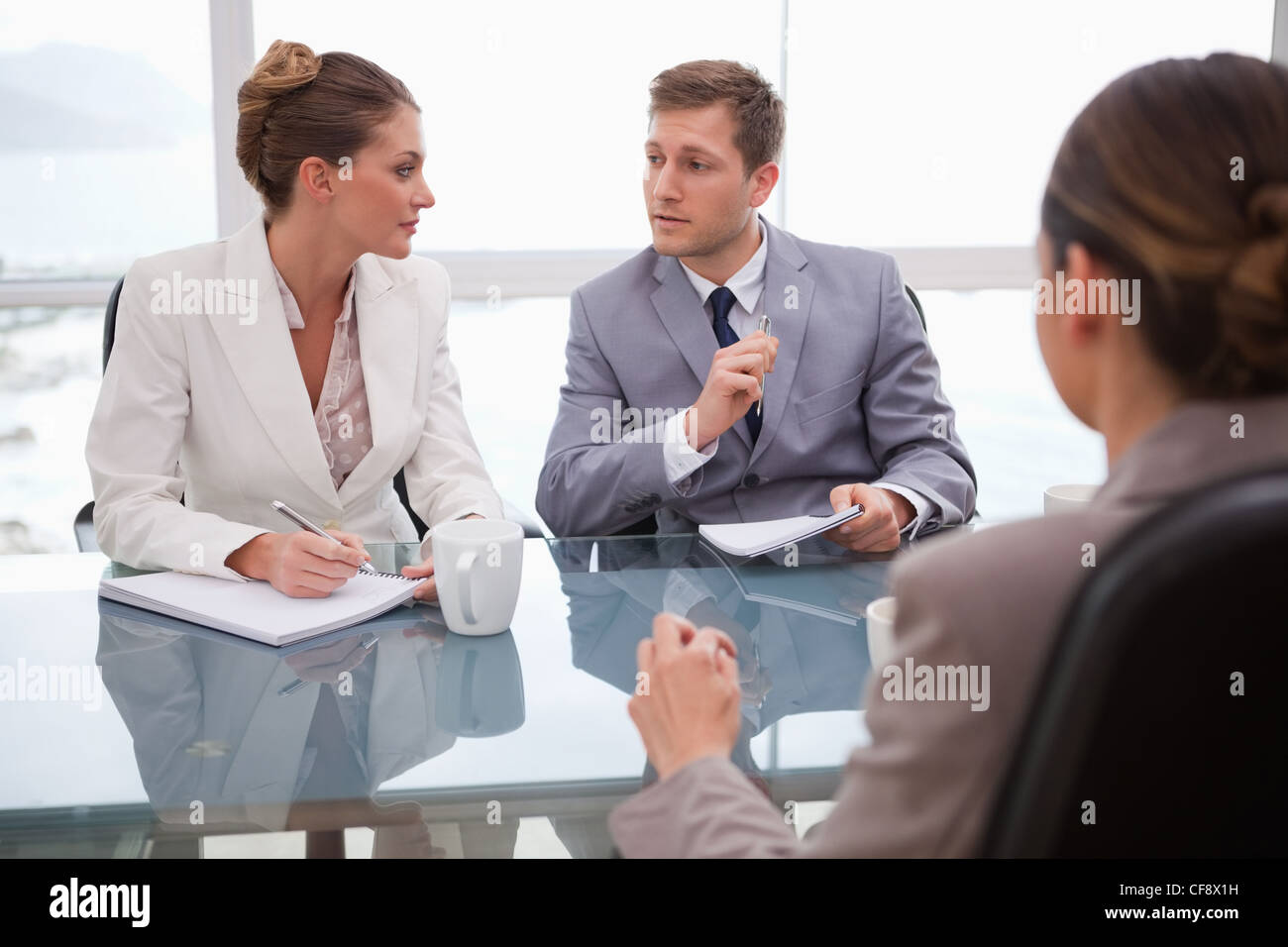 Business team deliberating with lawyer - Stock Image