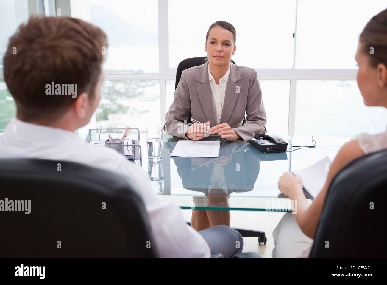 Lawyer advising her clients - Stock Image