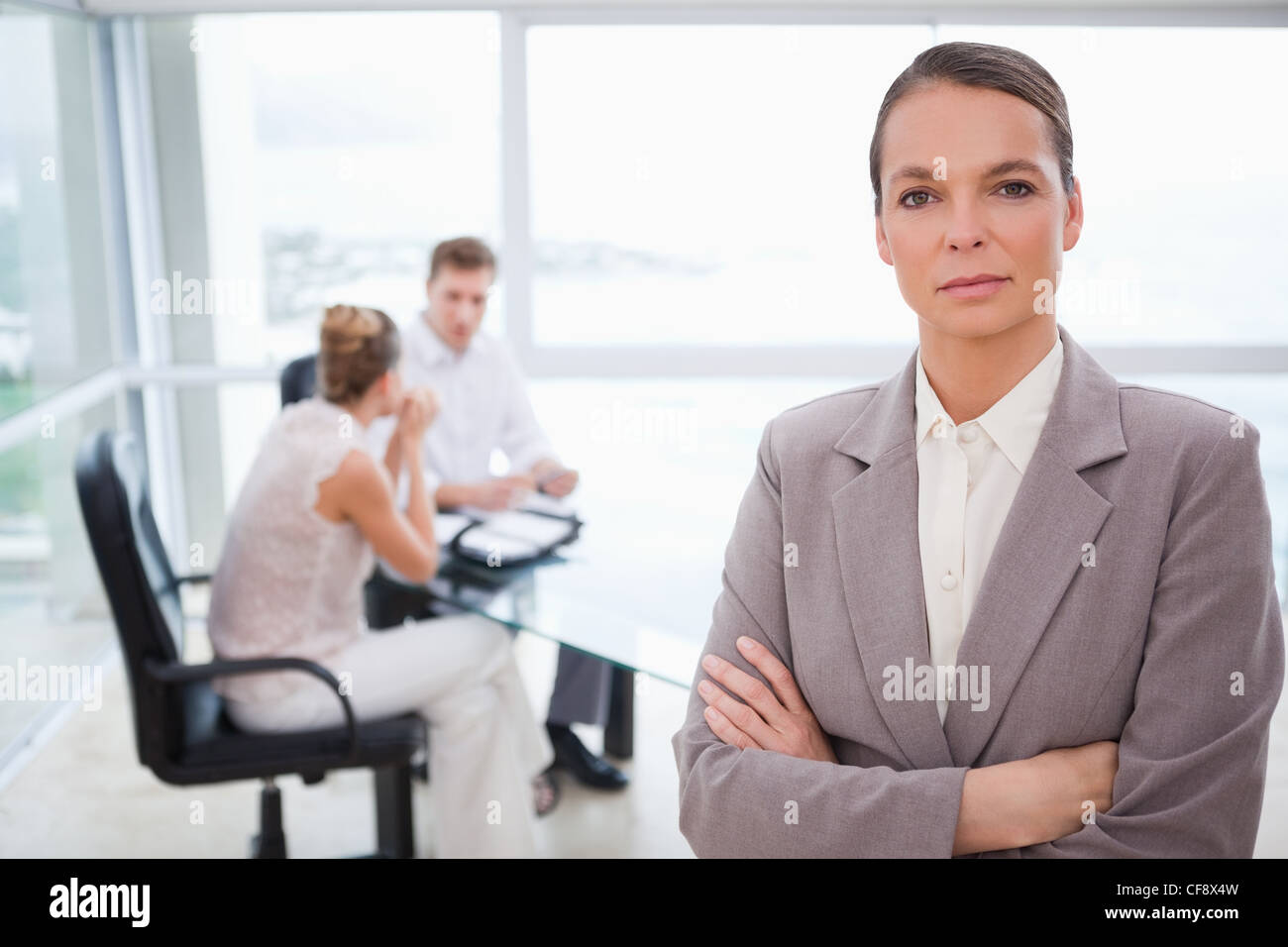 Consultant standing with folded arms - Stock Image