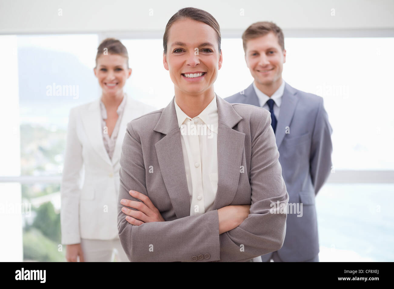 Business consultant with arms folded - Stock Image