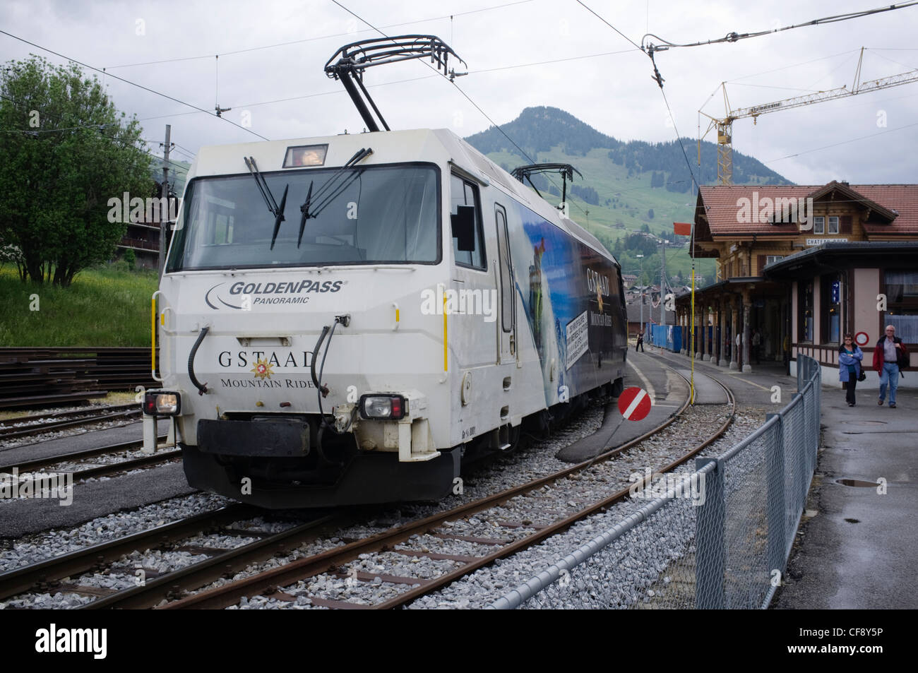 Golden Pass Panoramic express passing Montbovon station. Montreux-Oberland Bernois railway one of oldest electric Stock Photo