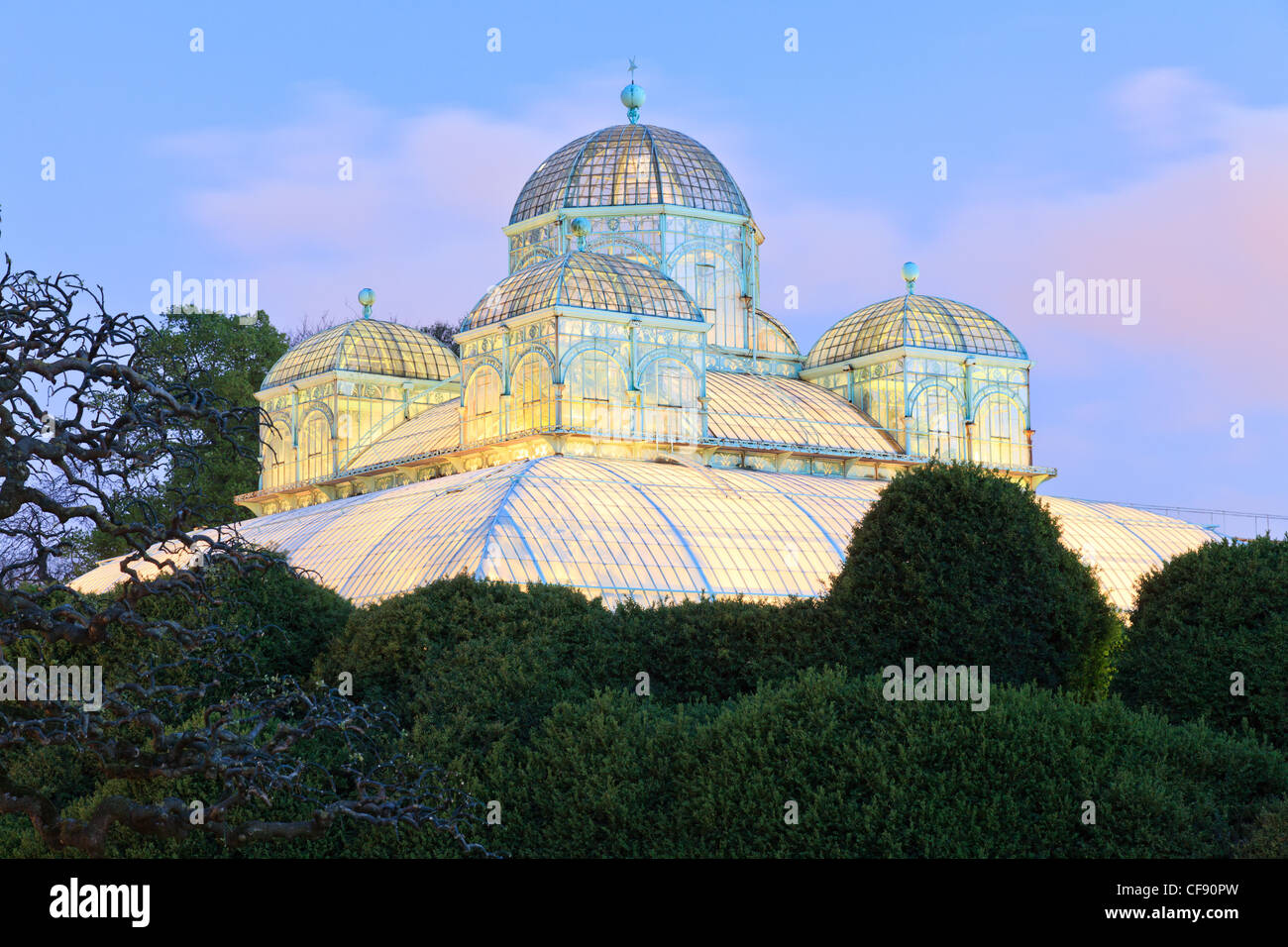 Belgium, Brussels, Laeken, the royal castle domain, the greenhouses of Laeken, the greenhouse of Congo by night. - Stock Image