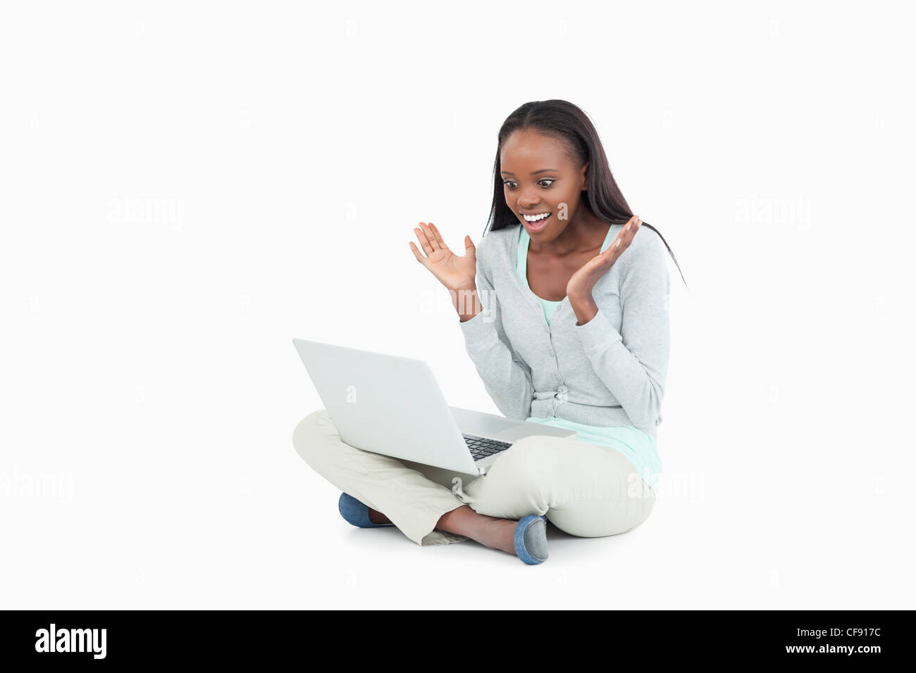 Young woman happy about whats on her screen - Stock Image