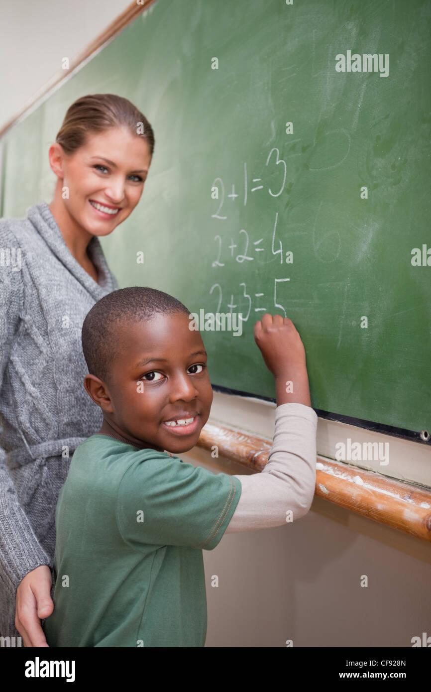 Portrait of a teacher explaining mathematics to a pupil - Stock Image