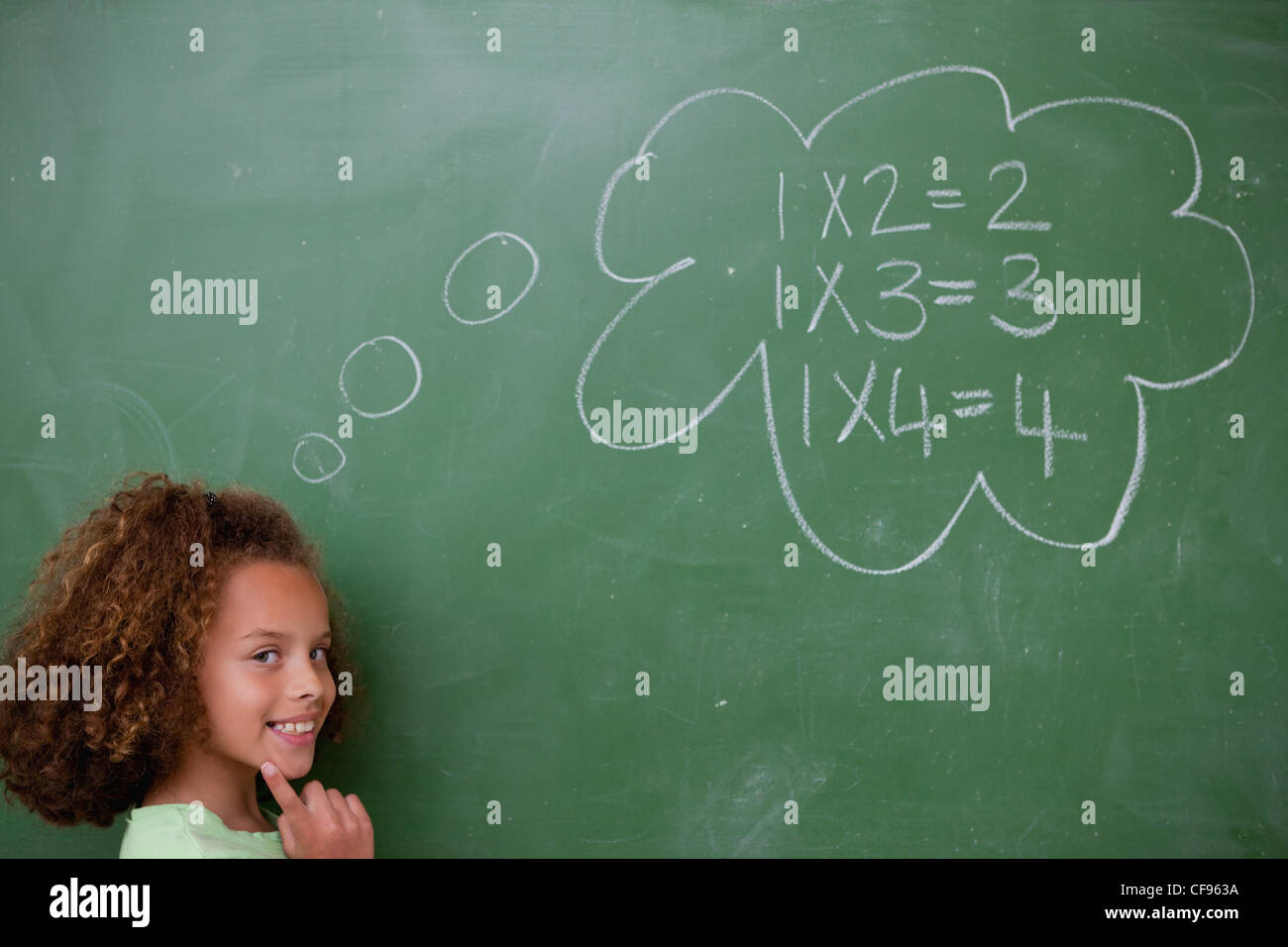 Schoolgirl thinking about mathematics - Stock Image