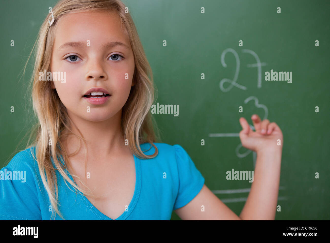 Little schoolgirl showing her result - Stock Image