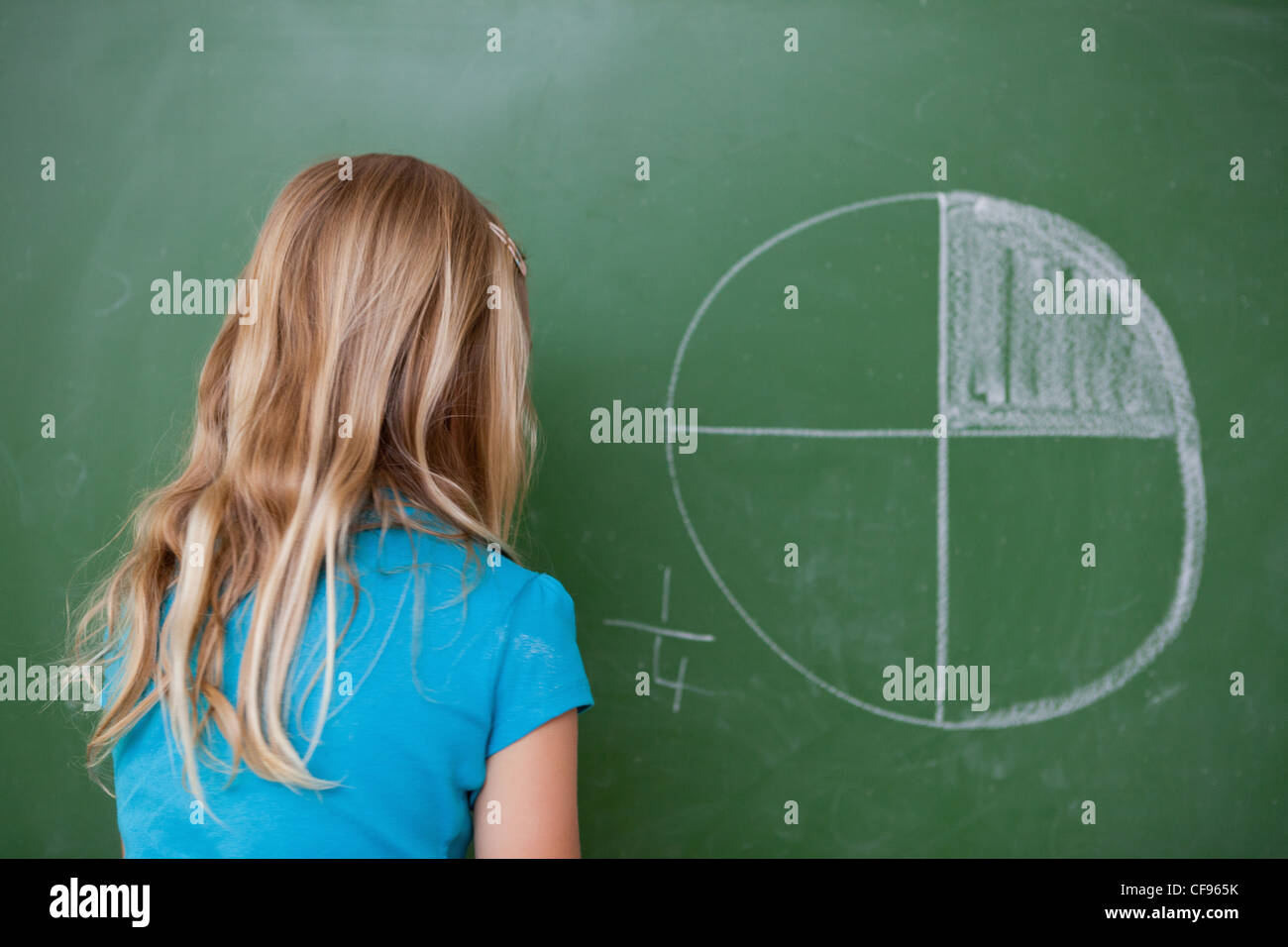 Schoolgirl learning the divisions - Stock Image