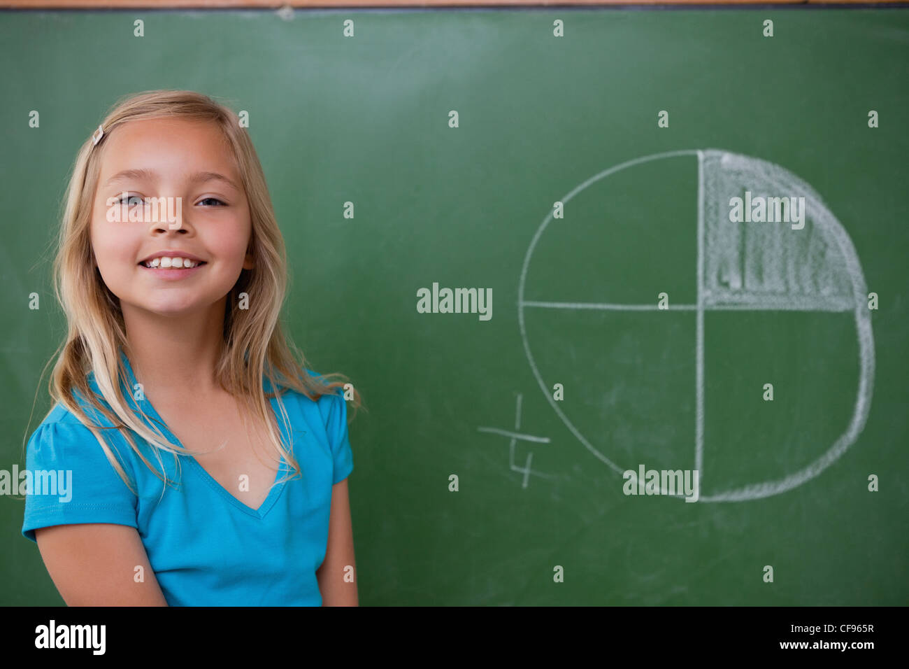 Smiling schoolgirl learning the divisions - Stock Image