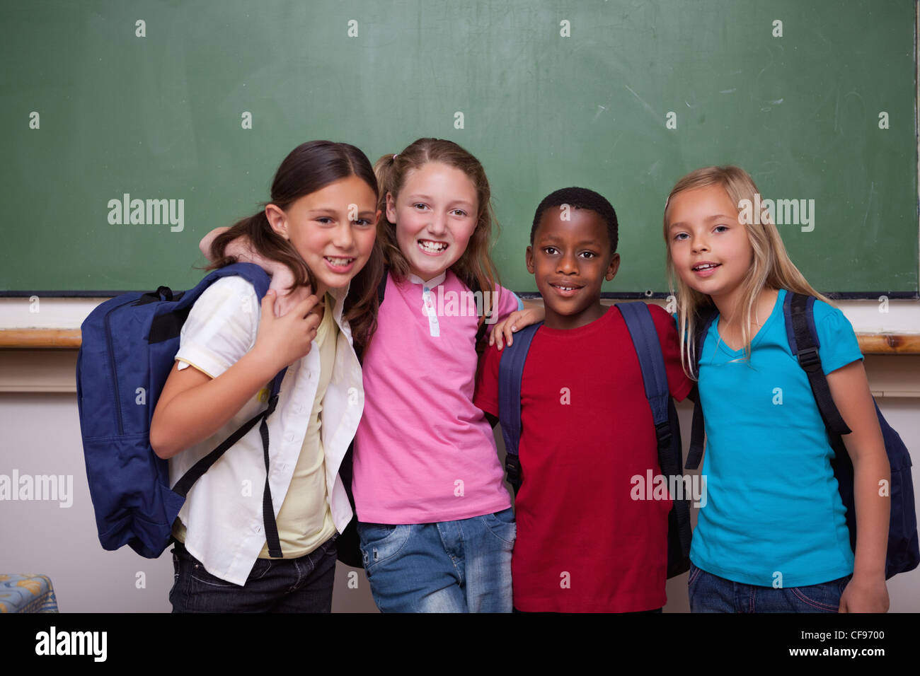 Classmates posing together - Stock Image