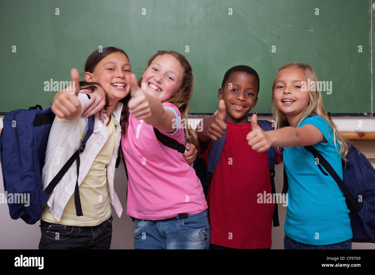 Classmates posing with the thumb up - Stock Image