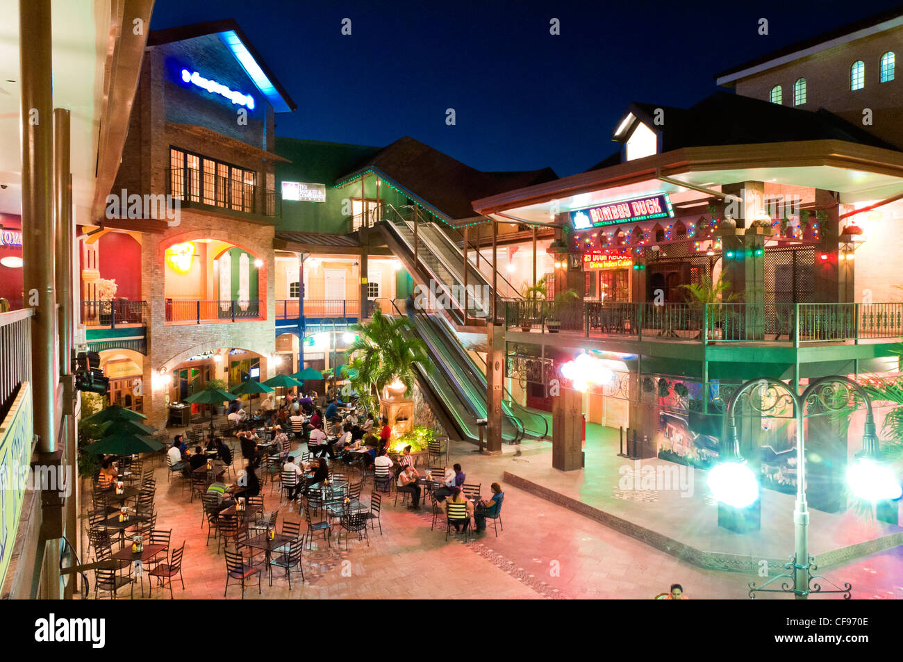 Movie towne, an entertainment complex in Trinidad at night. Open air restaurants, and nightlife. Stock Photo