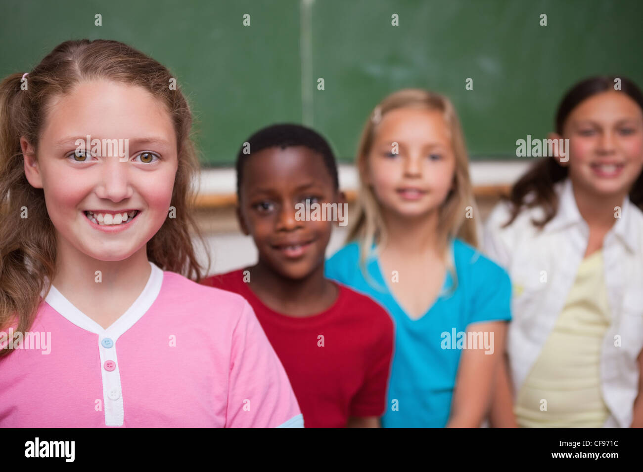 Classmates posing in a row - Stock Image