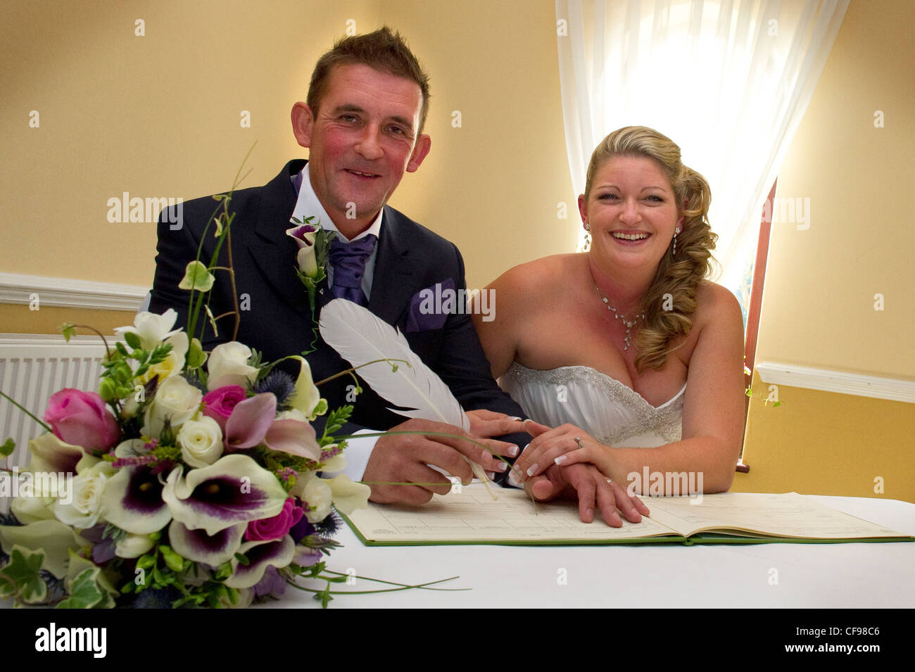 bride and groom signing wedding register stock photo 43844758 alamy