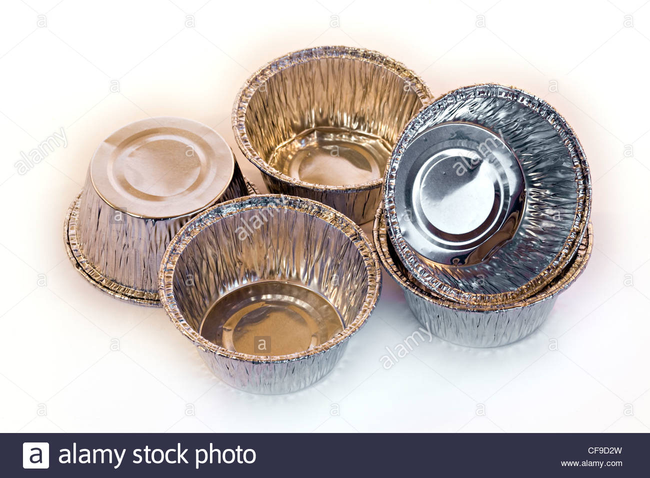Close-up of cup cake tins on white background - Stock Image