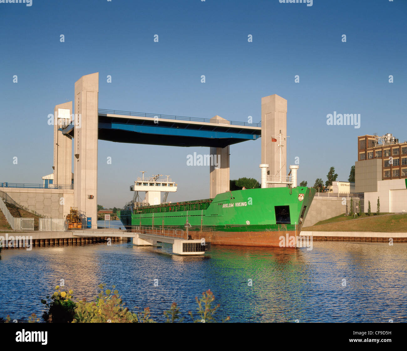 Manchester ship canal and Centenary Bridge raised for the passage of 'Arklow Viking' between Trafford Park - Stock Image