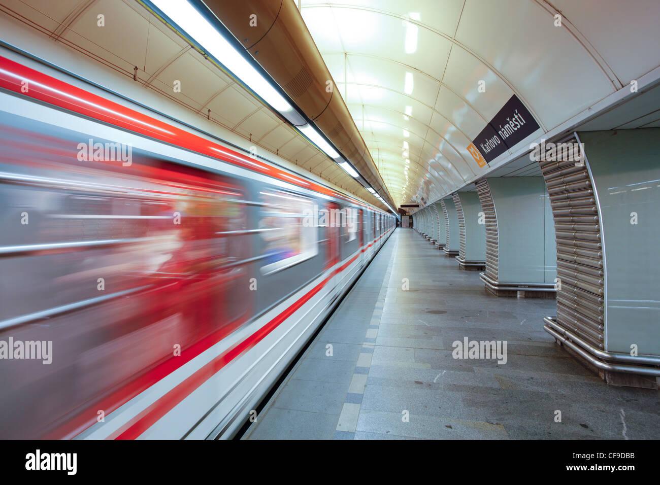 Train arriving at a platform in Prague underground Metro, blurred motion, Prague, Czech Republic - Stock Image
