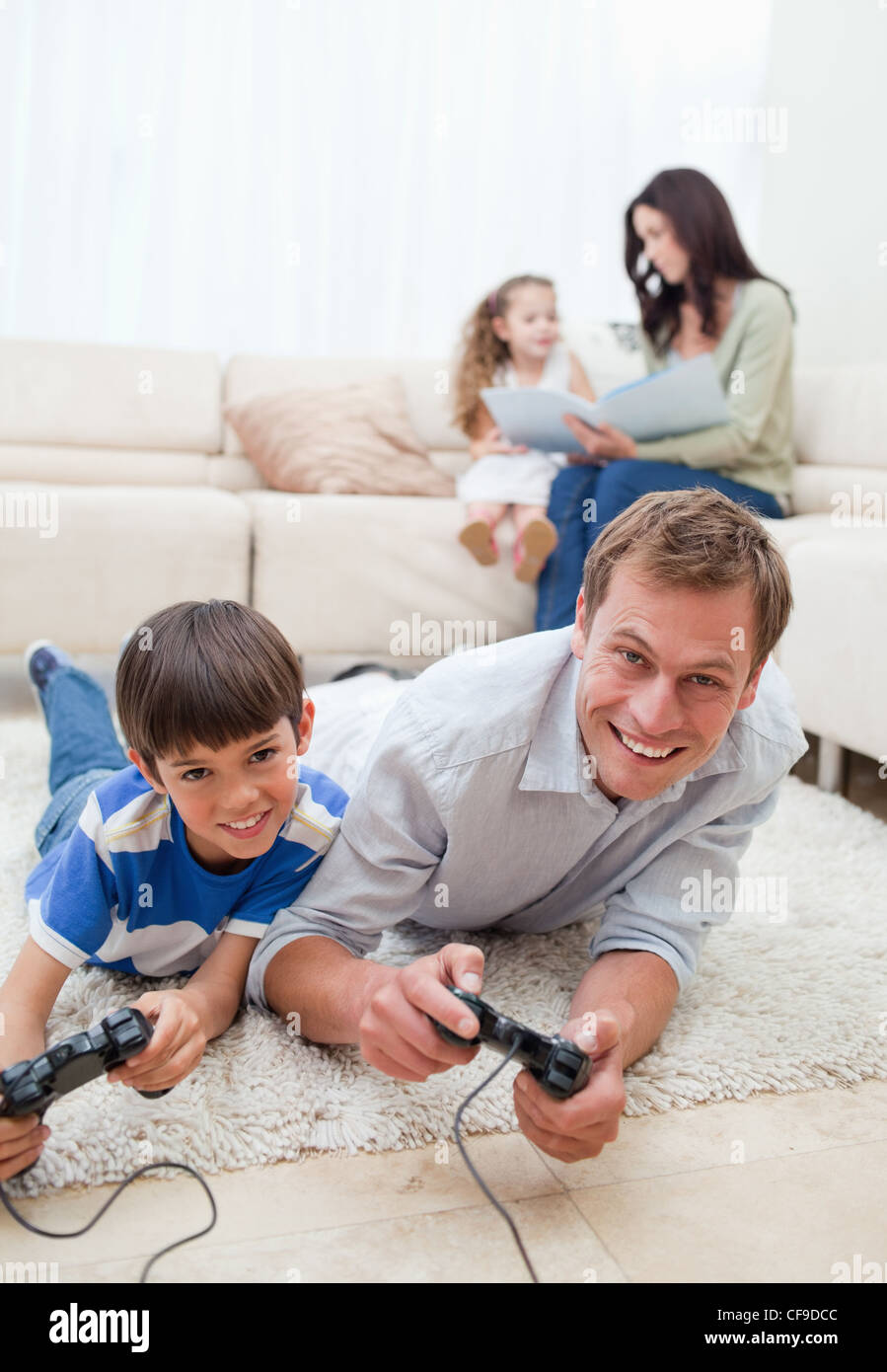Family enjoys spending their spare time together - Stock Image