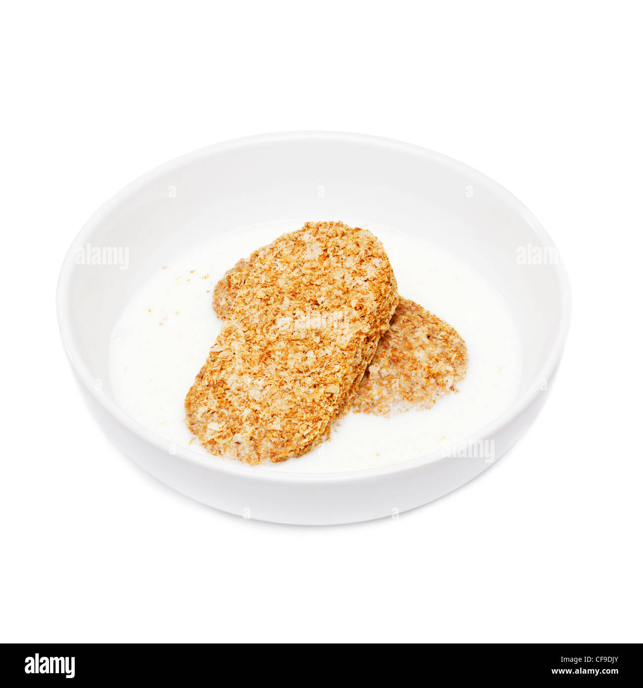 Weetabix breakfast cereal in a white bowl with milk - Stock Image