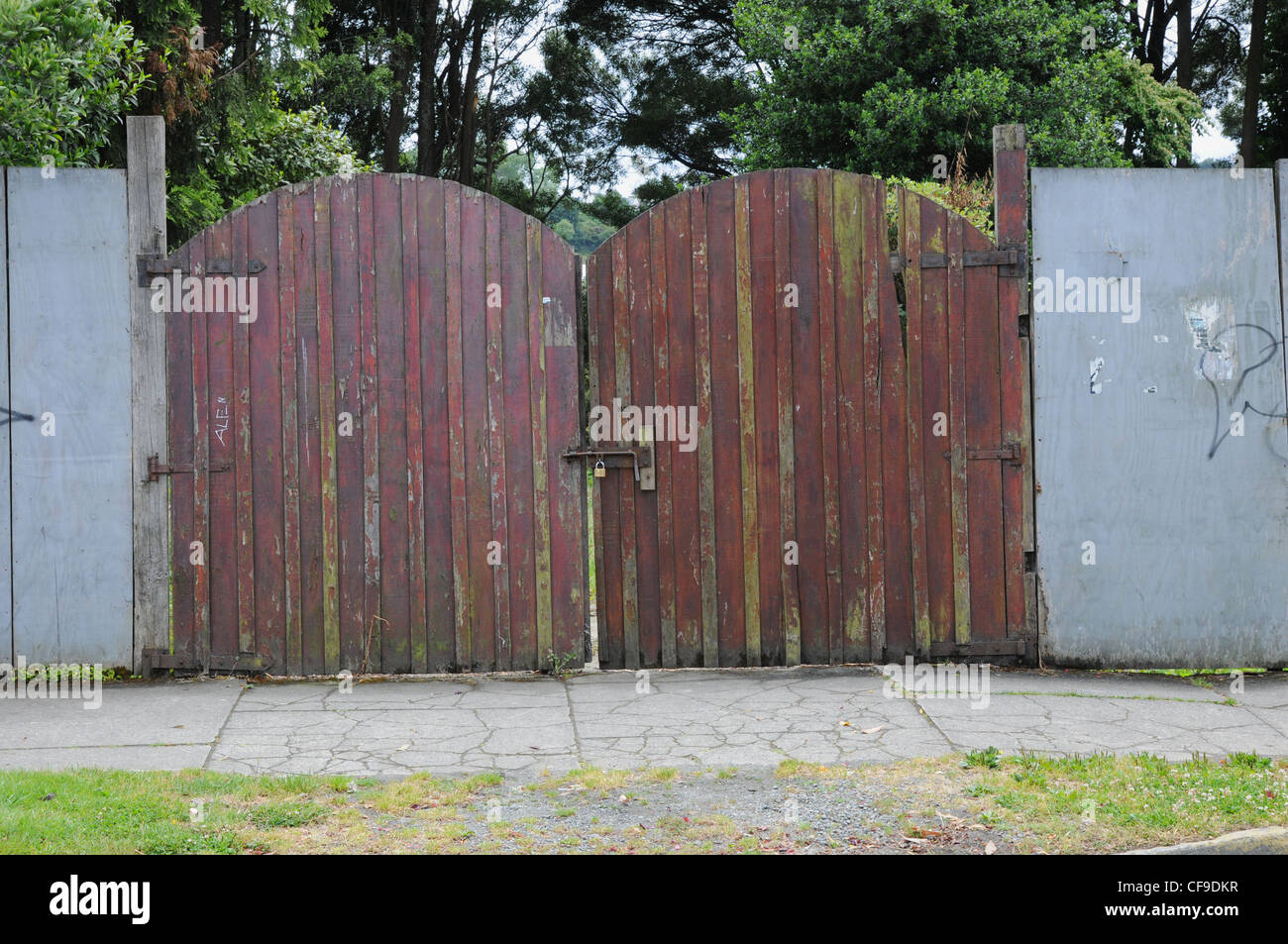 padlocked, insecure, brown wooden gates. - Stock Image