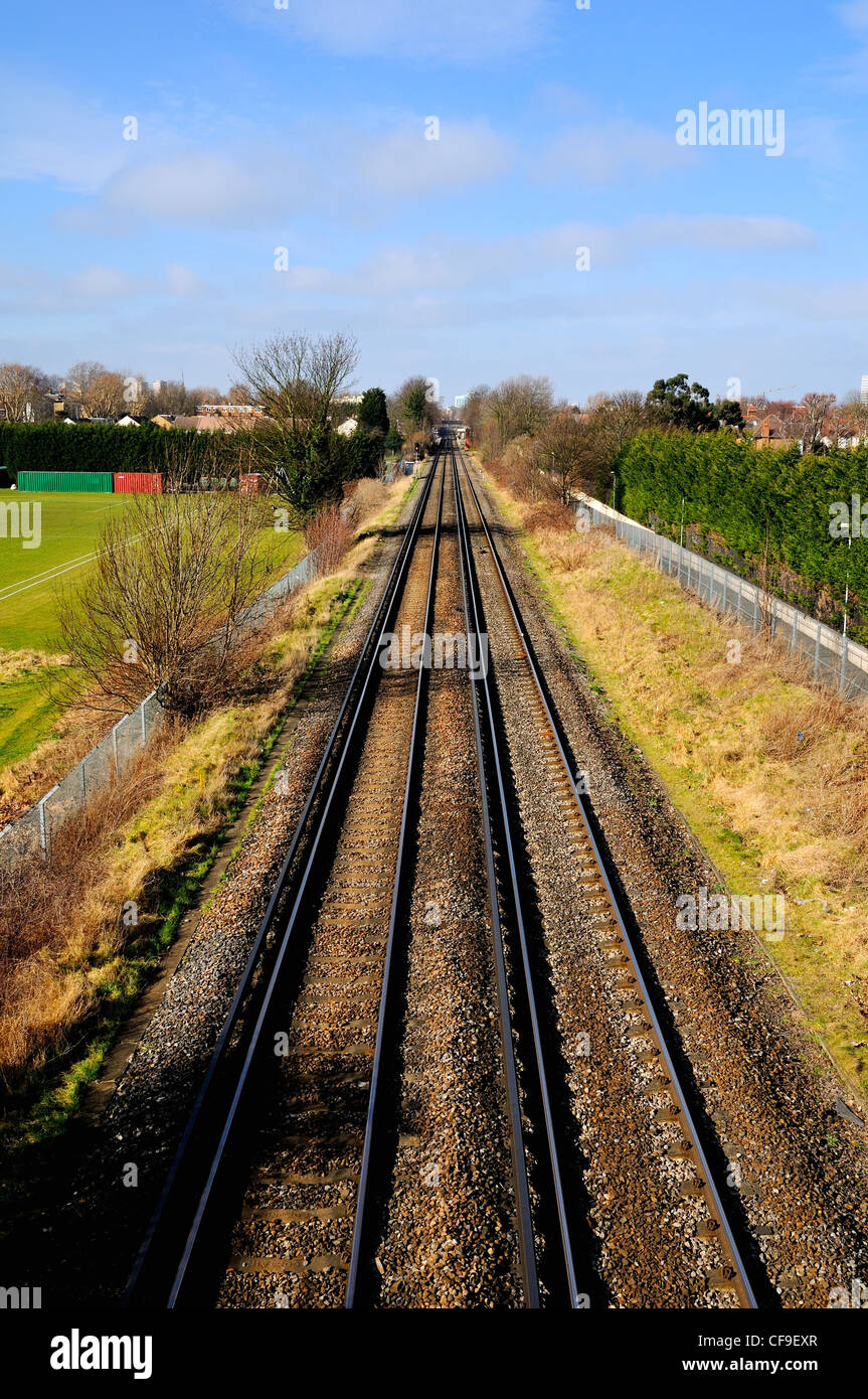 Railway lines disappearing into distance - Stock Image