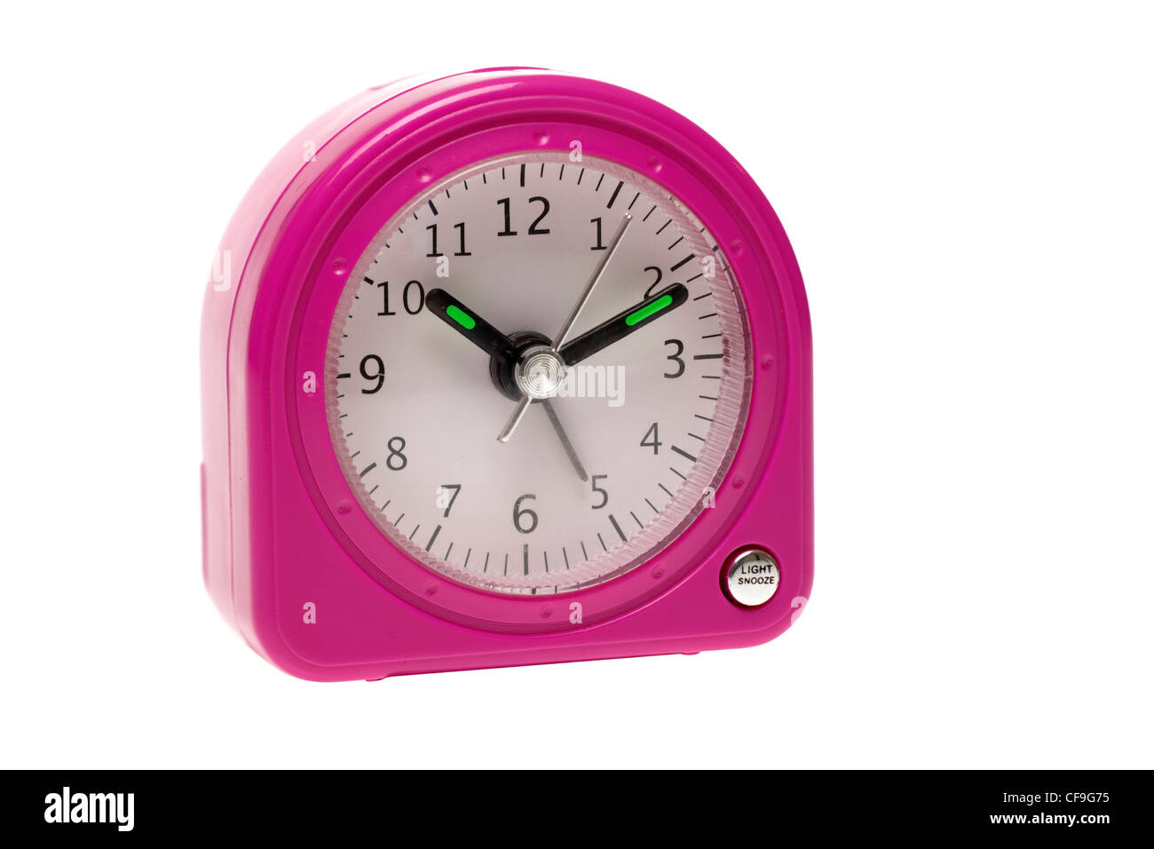 Small pink battery operated alarm clock - Stock Image