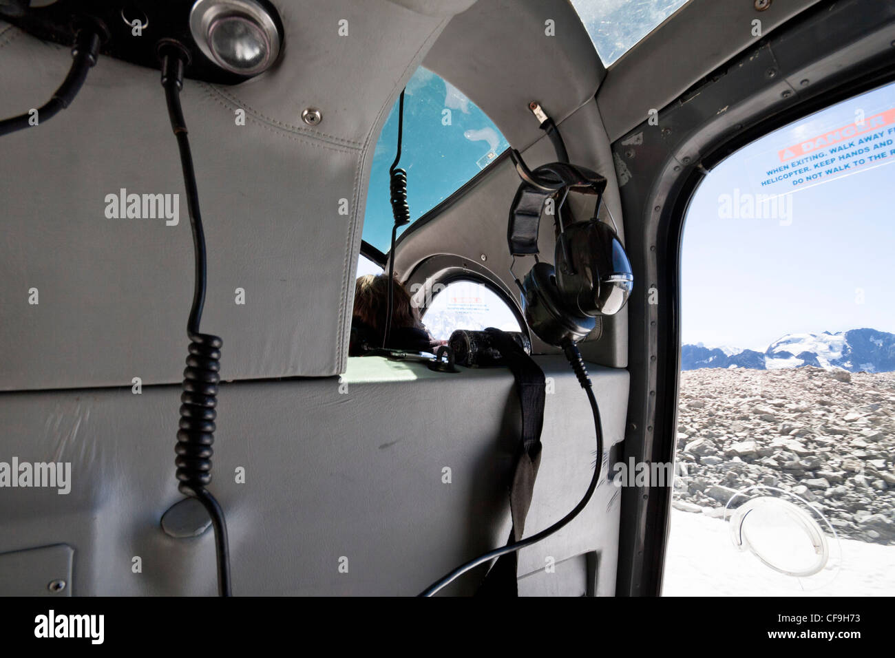 Inside mountain helicopter landing on peak of Mount Cook the highest mountain in New Zealand. - Stock Image