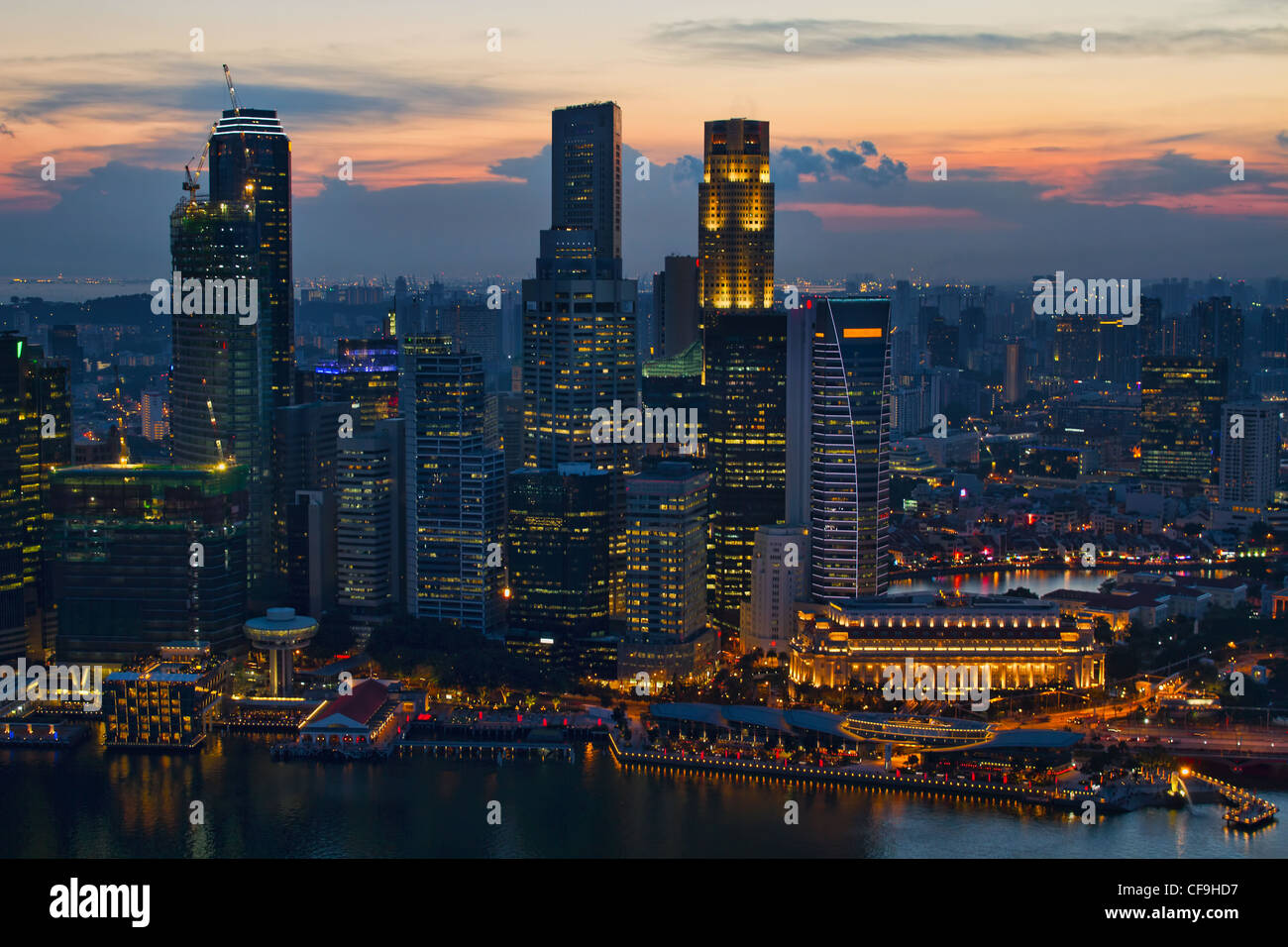 Sunset Over Singapore City Skyline Aerial View - Stock Image