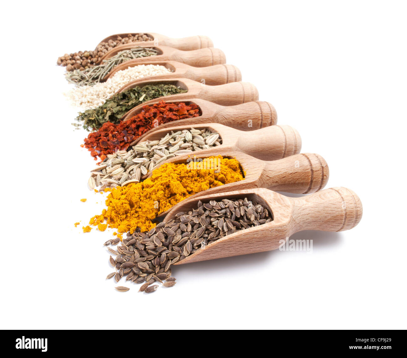 Row of wooden shovels with spices in them. Diminishing perspective - Stock Image