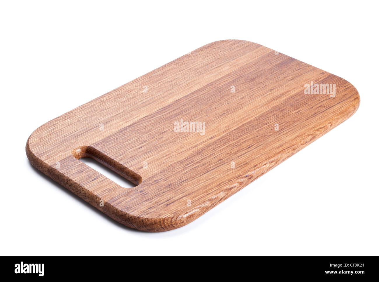 Wooden cutting board isolated on white background - Stock Image