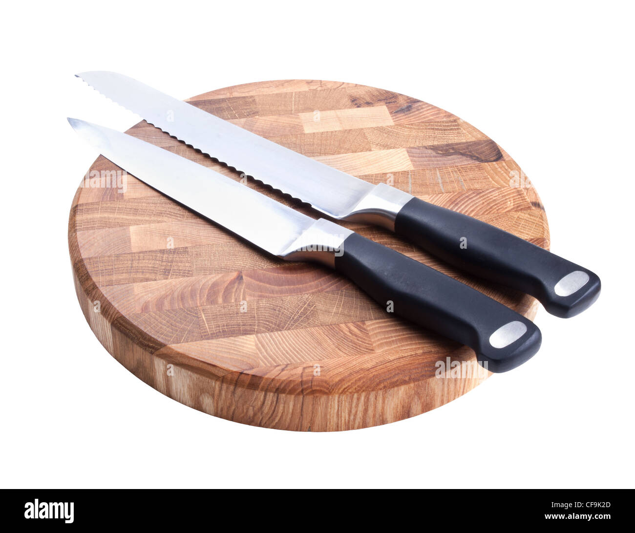 Two knives and wooden cutting board isolated on white background - Stock Image