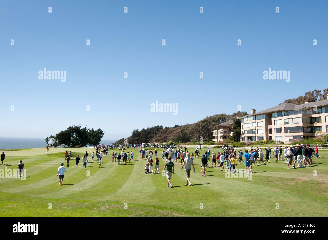 Spectators and golfers unknown. Championship golf. - Stock Image