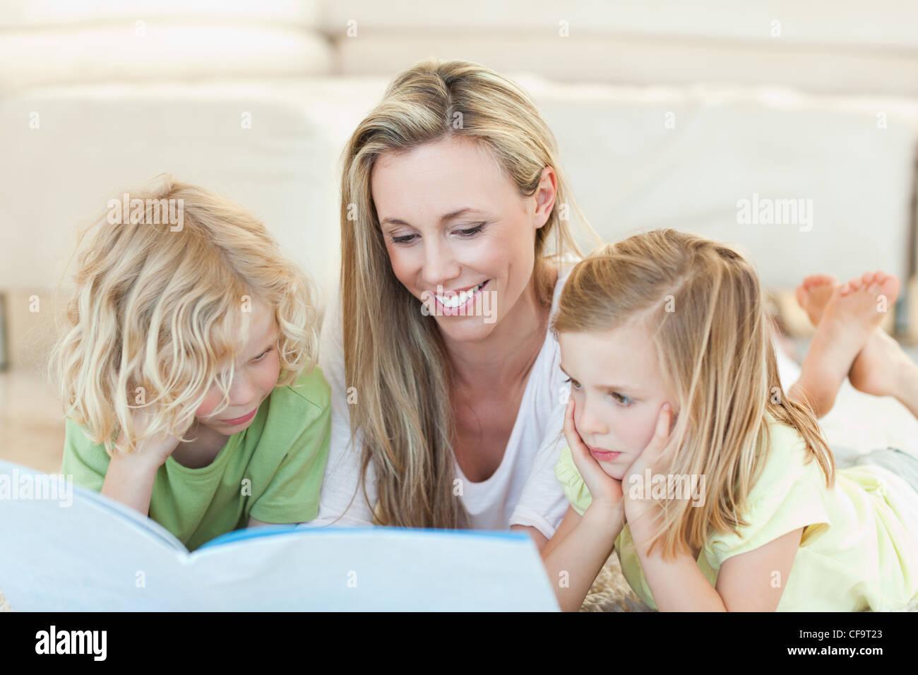 Mother reading story for children - Stock Image