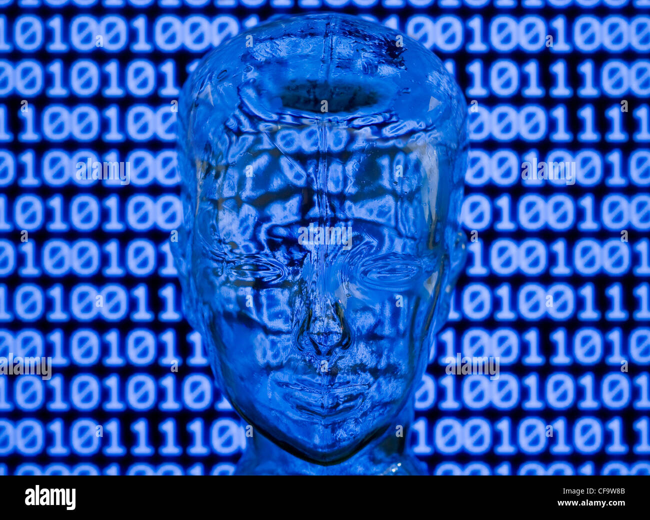 Glass head in front of binary code - Stock Image