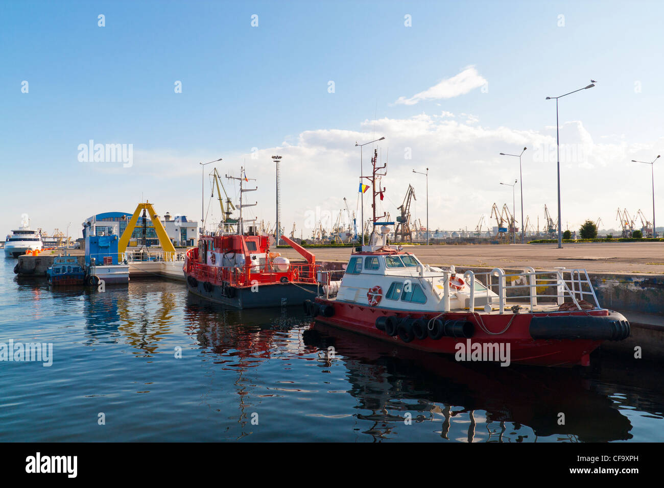 Two anchored towboats in port. - Stock Image