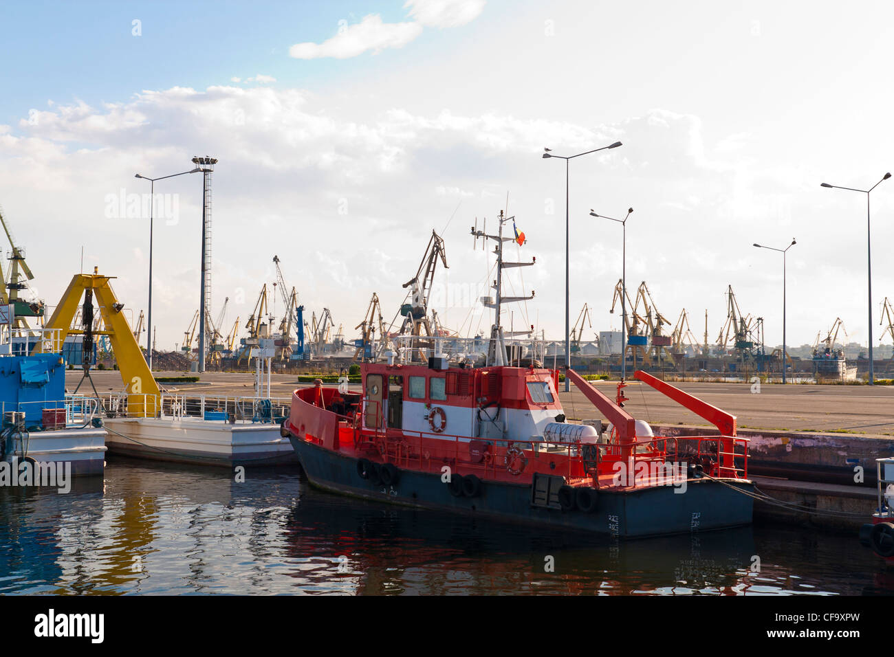 Anchored red towboat in port. - Stock Image