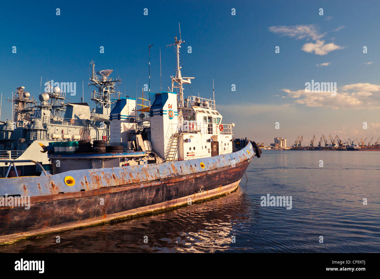 Old towboat docked in port. - Stock Image