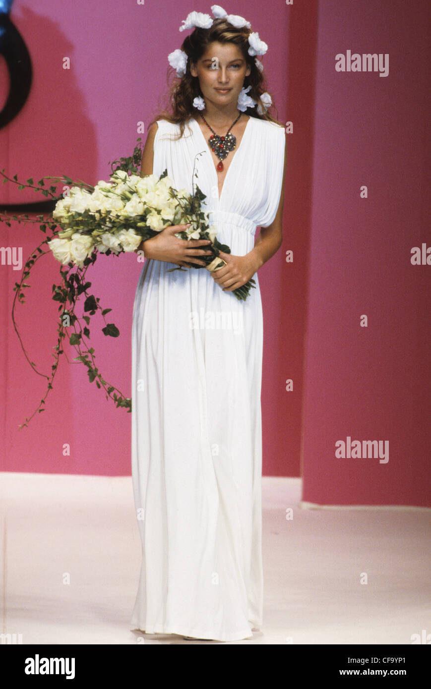 607a9a420b6 Yves Saint Laurent Spring Summer French model Laetitia Casta wearing white  grecian dress accessorized floral garland, and