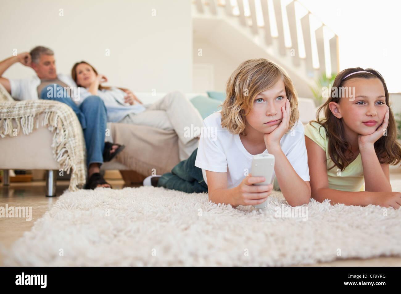 Siblings bored by tv program - Stock Image