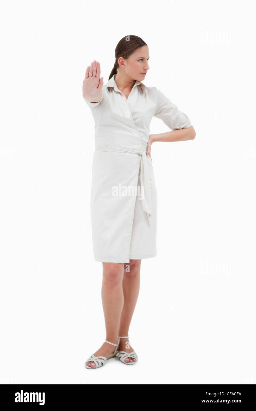 Portrait of a businesswoman making a stop sign - Stock Image