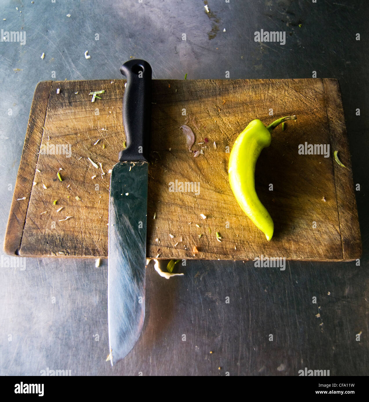 A Green Chilly and a knife. - Stock Image