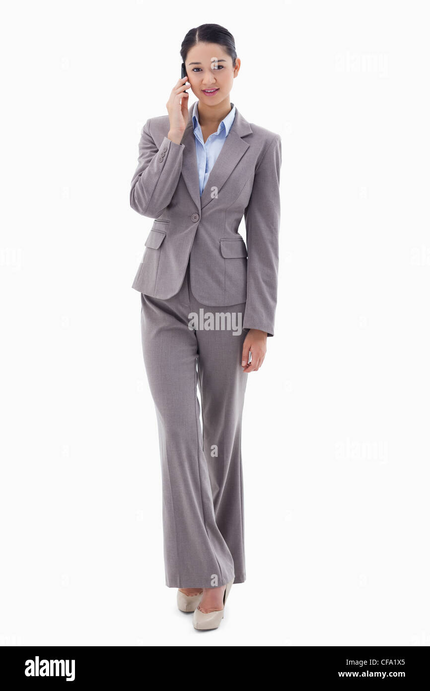 Portrait of a young businesswoman making a phone call - Stock Image