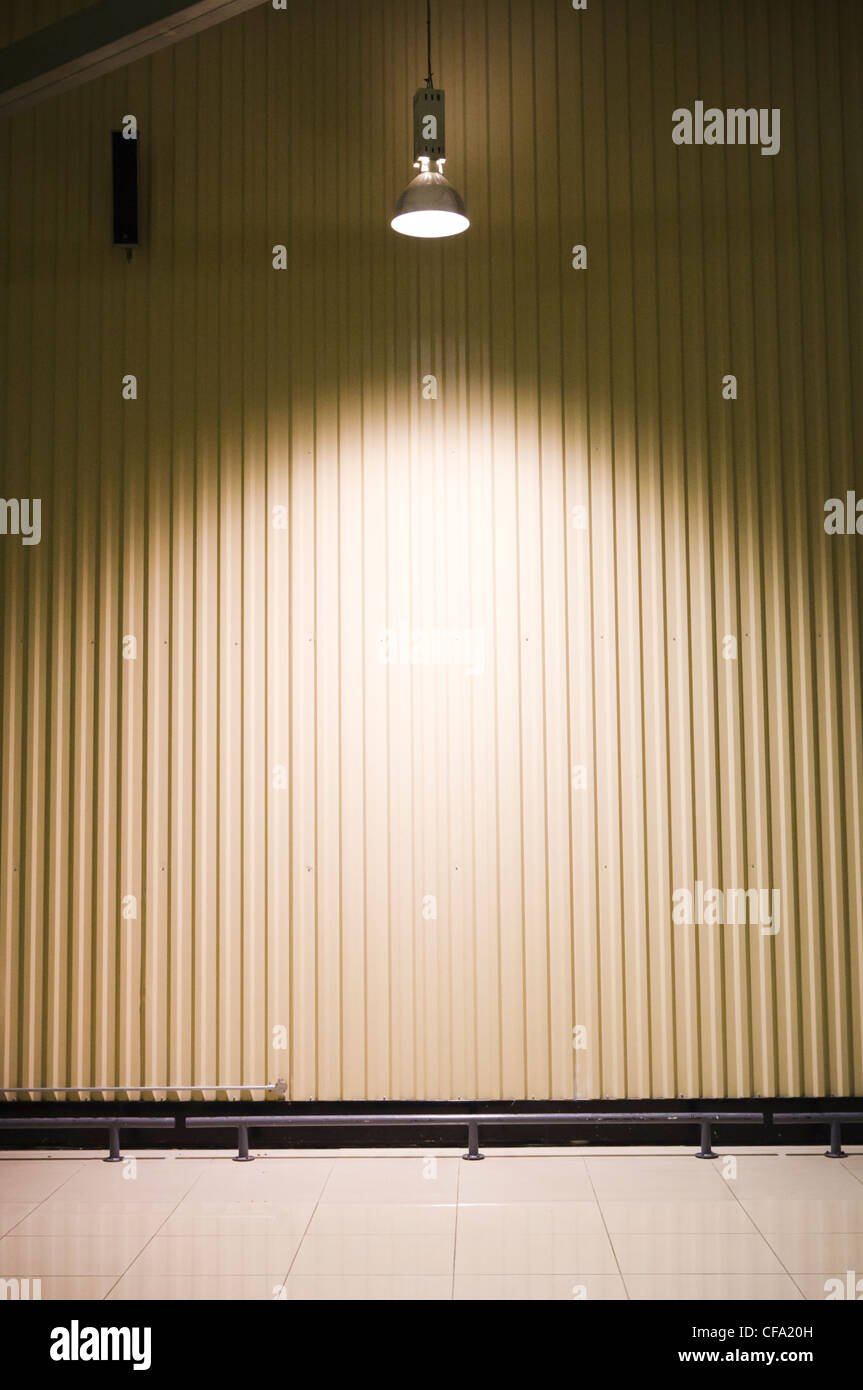empty warehouse with a headlight on ceiling, for out of stock concepts. - Stock Image