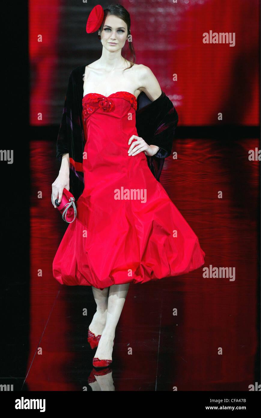 Armani Ready to Wear Milan A W A brunette female model wearing a red ...