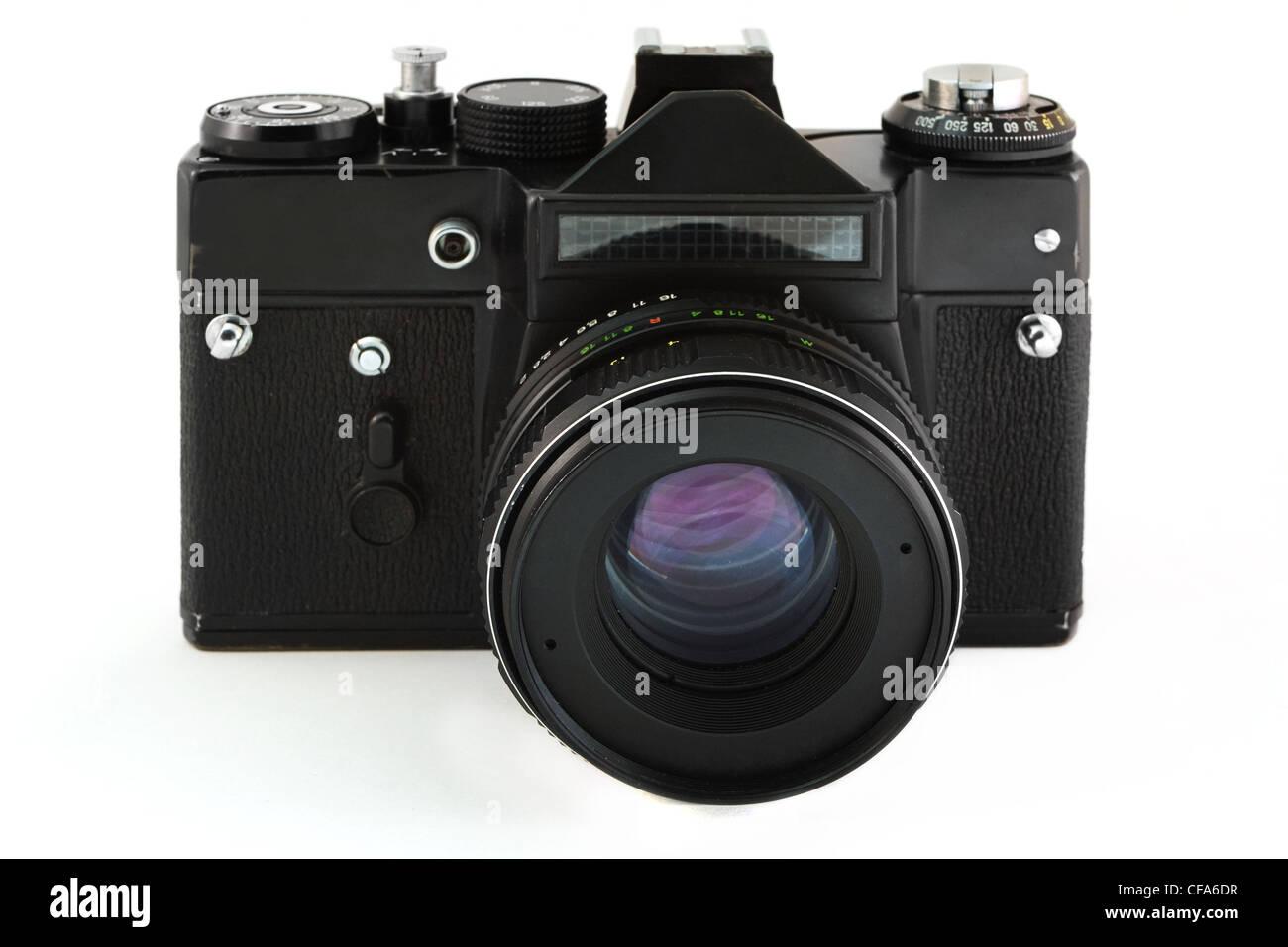 Old 35m film camera over white - Stock Image