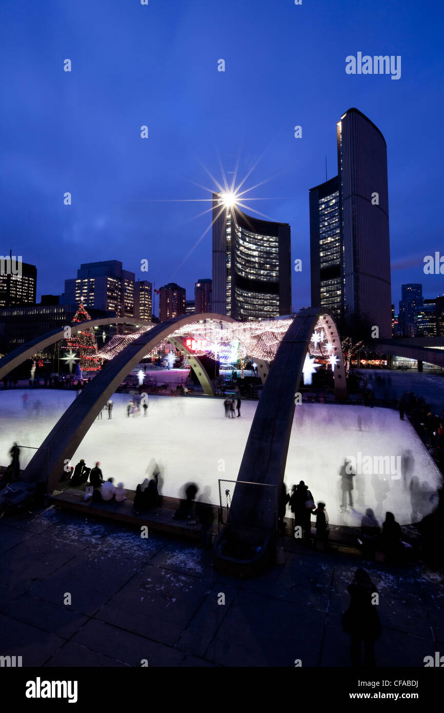 Evening Skaters outdoors Nathan Phillips Square - Stock Image